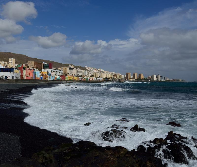 Beach and city, Las Palmas de Gran Canaria. Rough sea and city, San Cristobal beach, coast of Las Palmas de Gran Canaria, Canary Islands royalty free stock images