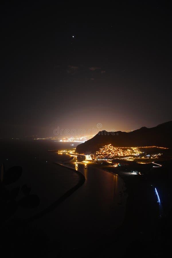 Beach and city night view stock image