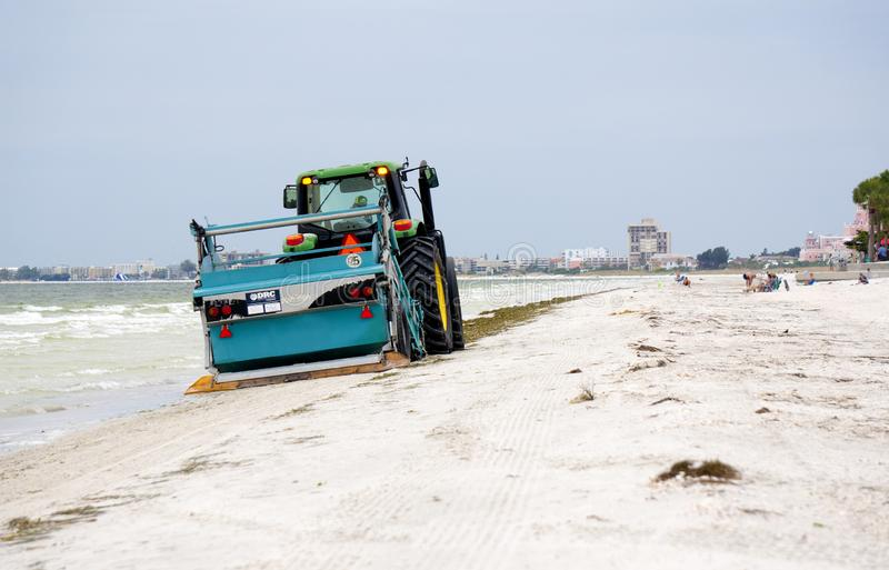 Beach cleaner on the Gulf of Mexico at St. Pete Beach, Florida. St. Pete Beach, Florida, October 23, 2018: A tractor pulling a beach cleaning machine moves royalty free stock images