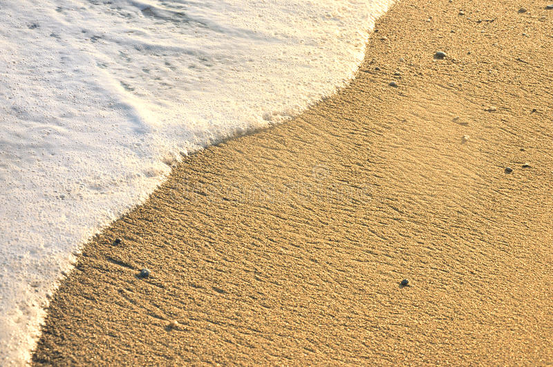 Beach with clear water. And waves royalty free stock image