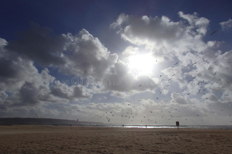 Beach and cloudscape Nazare Portugal royalty free stock images