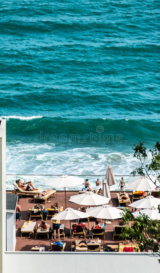 Beach club on a hotel roof. Black Sea waves. Beach club on a roof of 4 stars Grifid Hotel Encanto. Panoramic view to the Black Sea water, waves and a sandy beach royalty free stock image