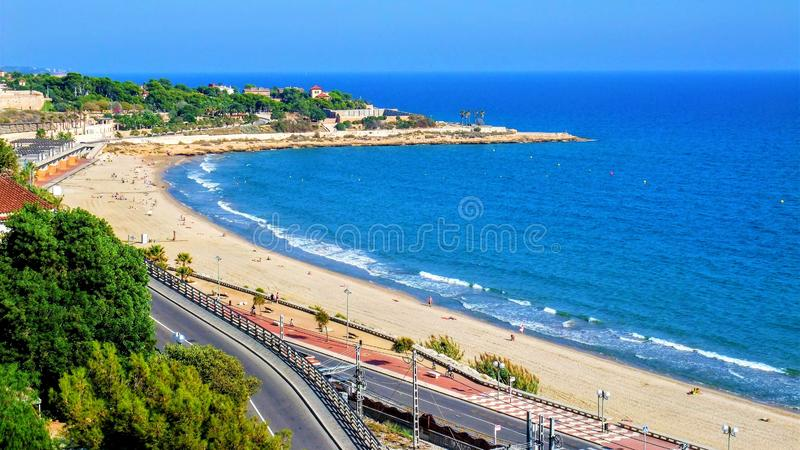 Beach on a coast in Spain. Tarragona beach on a coast in Spain a beautiful summer day, located about one hundred kilometers south of barcelona stock image