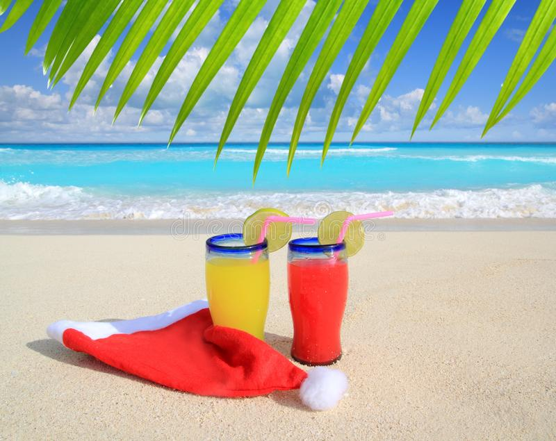 Beach cocktails with Santa christmas hat stock photo