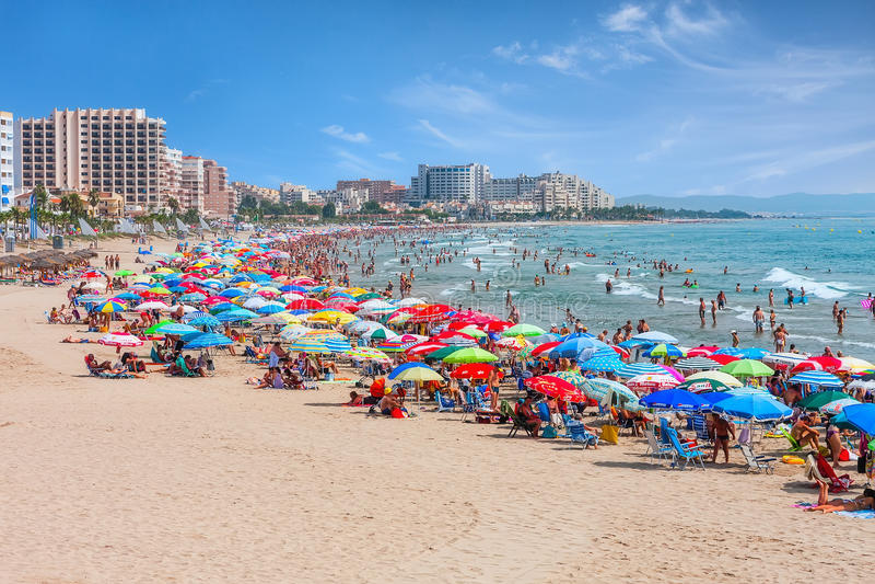 Colorful Beach Umbrellas On A Mediterranean Sandy Beach