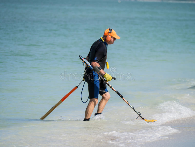 Jew Detector: Beach Comer With Metal Detector On The Beach Editorial