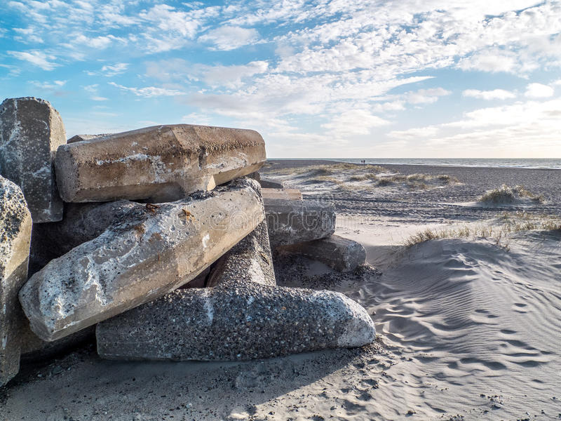 Beach with concrete pillars as protection stock photography