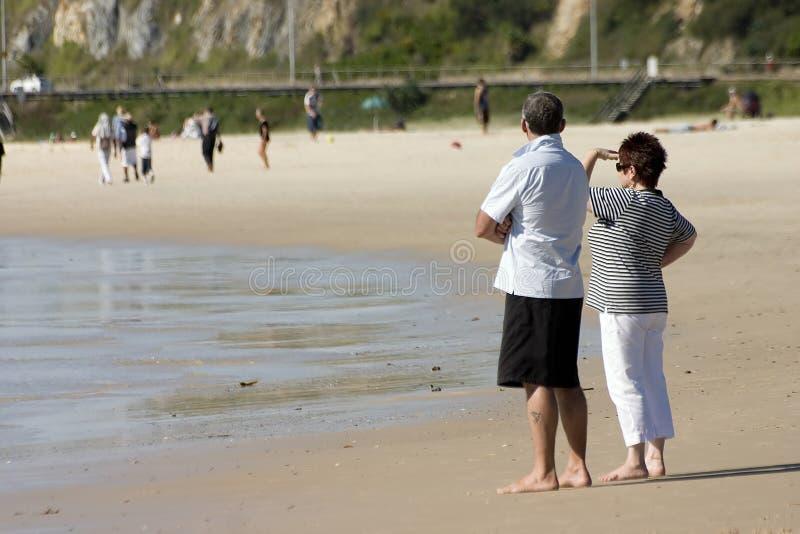 Beach Couple. Senior couple looking away stock photo