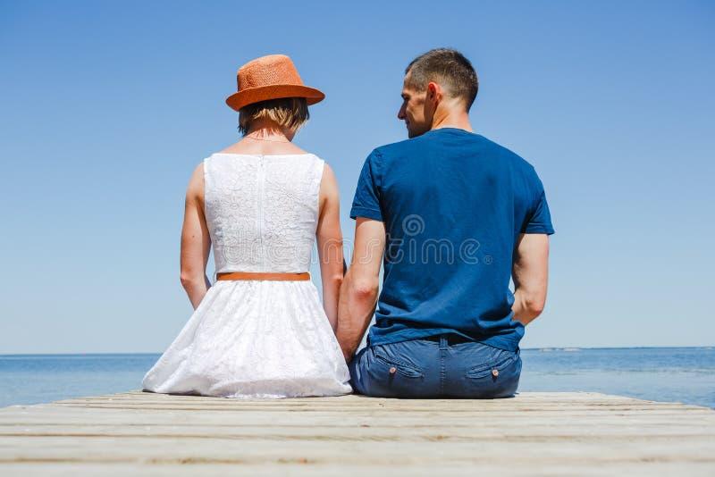 Beach couple enjoying holiday royalty free stock images