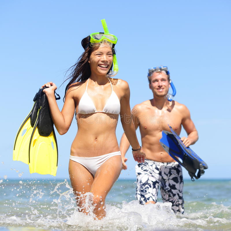 Beach couple having fun on vacation travel snorkel stock image