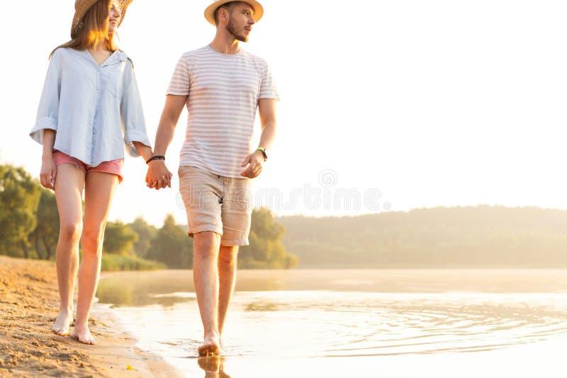 Beach couple walking on romantic travel honeymoon vacation summer. stock image