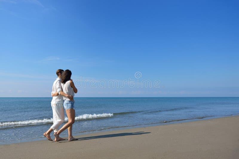 Beach couple walking on romantic travel honeymoon vacation summer holidays romance. royalty free stock photography