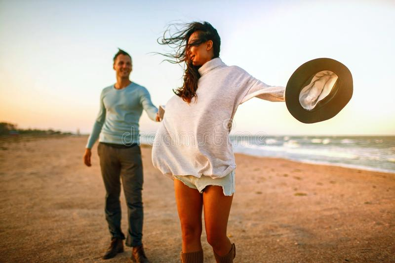 Beach couple walking on romantic travel honeymoon vacation summer holidays romance. stock photo
