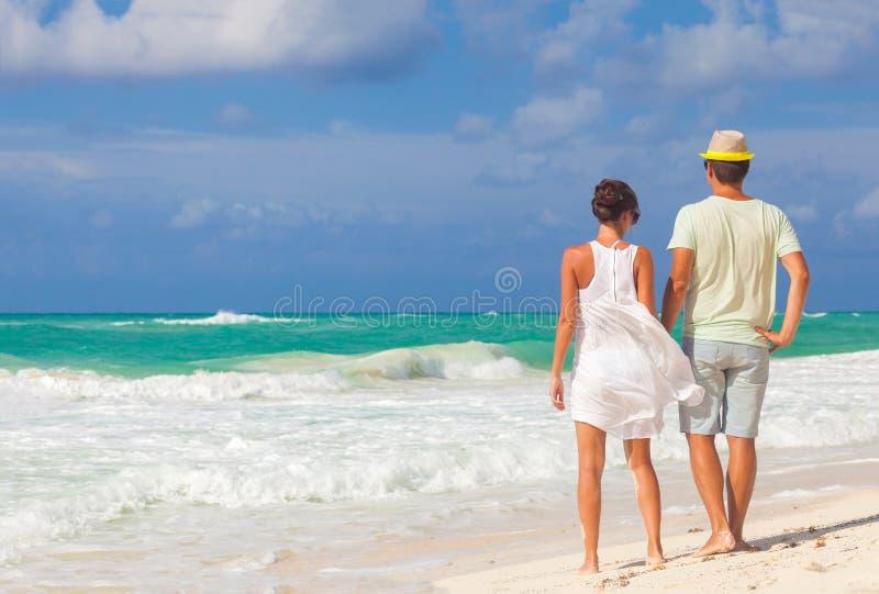Beach couple walking on romantic travel honeymoon vacation summer holidays romance. Young happy lovers, Cayo LArgo, Cuba royalty free stock photos