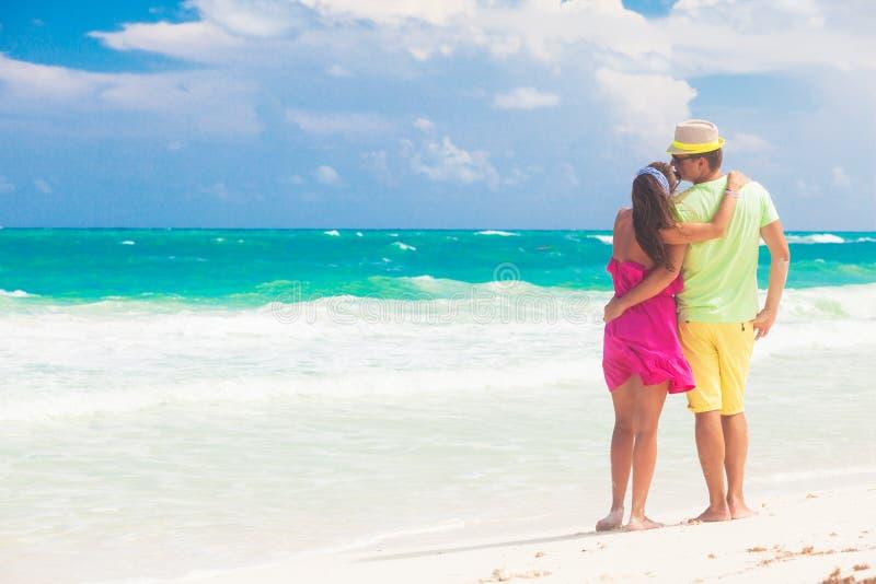 Beach couple walking on romantic travel honeymoon vacation summer holidays romance. Young happy lovers, Cayo LArgo, Cuba stock photo
