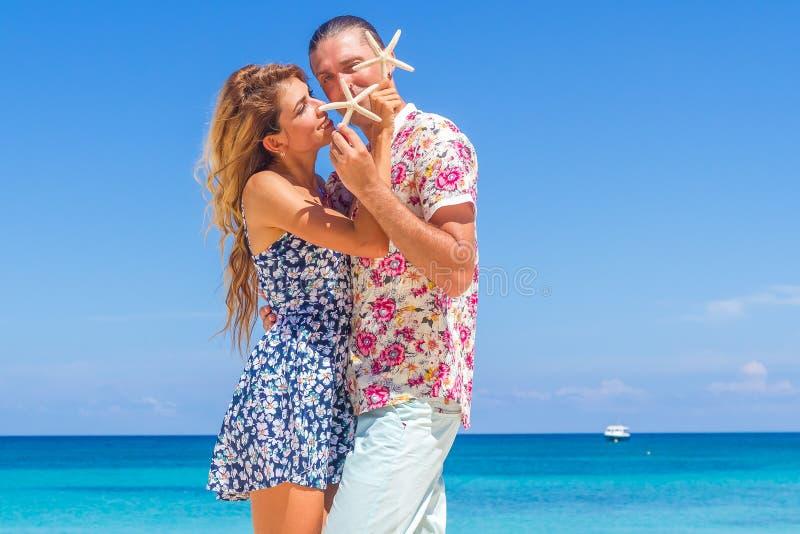 Beach couple walking on romantic travel honeymoon vacation summer royalty free stock photography