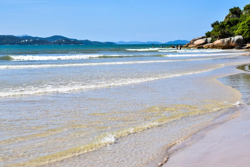 A calm beach in southern Brazil. This is the beach of Daniela, a place of calm waters and with mild temperature, ideal for children and the whole family. It is royalty free stock photos