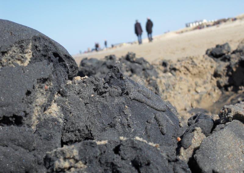 Beach with a dark sand pile stock photo