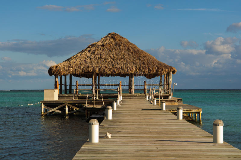 Beach Deck with Palapa. Floating in the water royalty free stock images