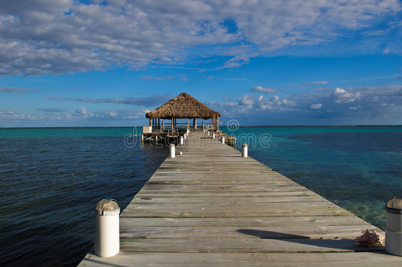 Beach Deck with Palapa. Floating in the water stock photos