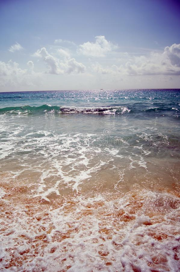 A beach is a deposit of unconsolidated sediments that vary between sand and gravel stock photography