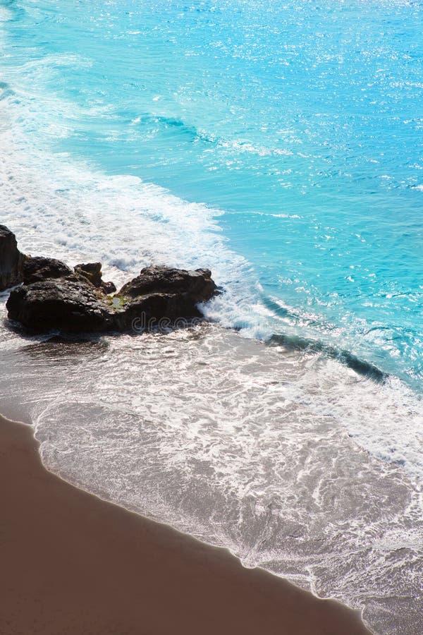 Beach el Bollullo black brown sand and aqua water royalty free stock image