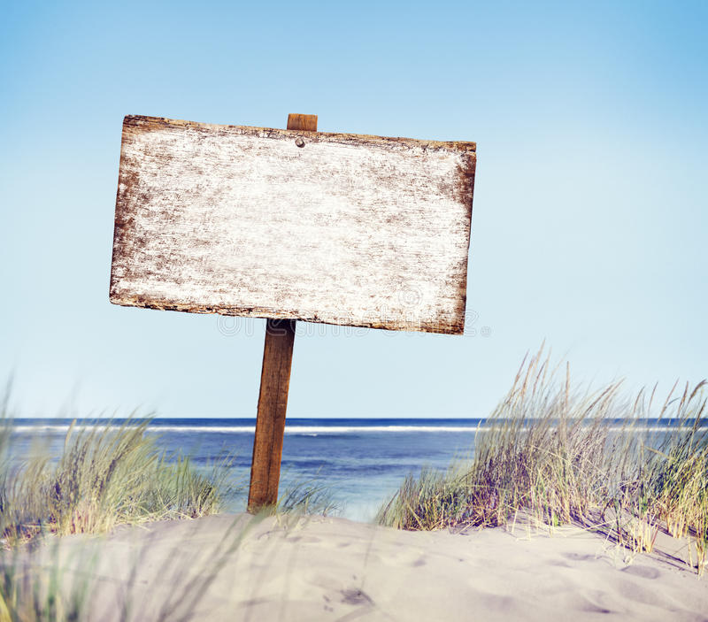 Beach with Empty Plank Sign royalty free stock images