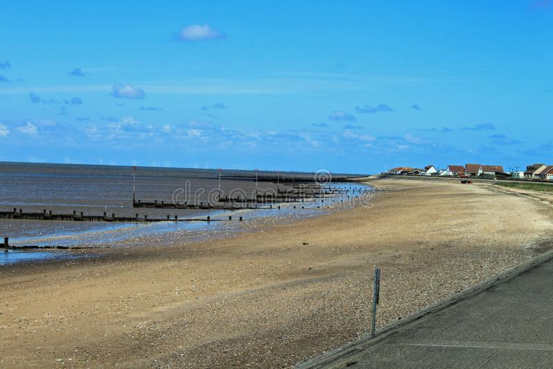 A beach in England with a series of breakwater`s royalty free stock photos