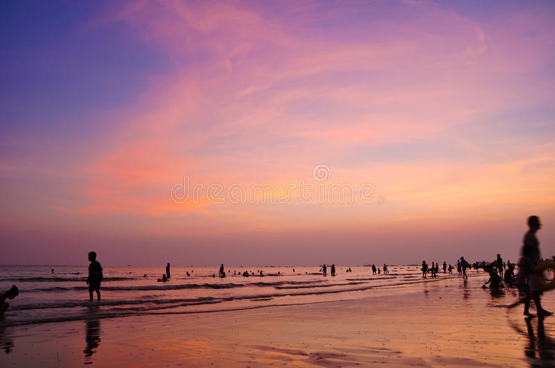 Beach in the evening. Summer evening on the beach, people in the play royalty free stock images