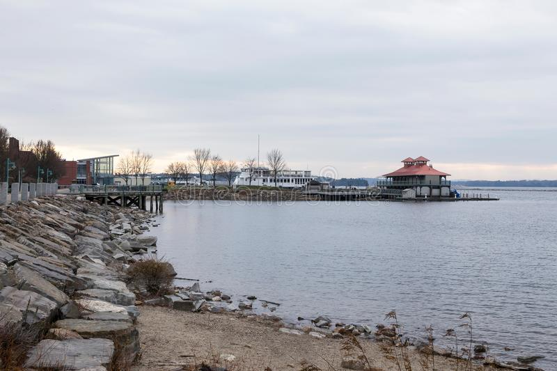 Beach and ferry in port next to boathouse in Burlington, Vermont royalty free stock photo