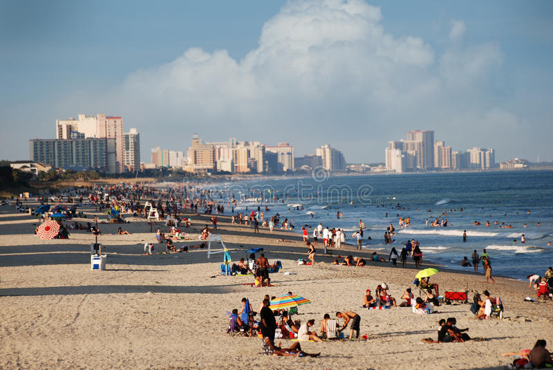 Beach filled with people in Myrtle Beach, South Carolina. stock photo