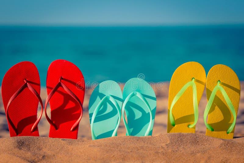 Beach flip-flops on the sand stock photo