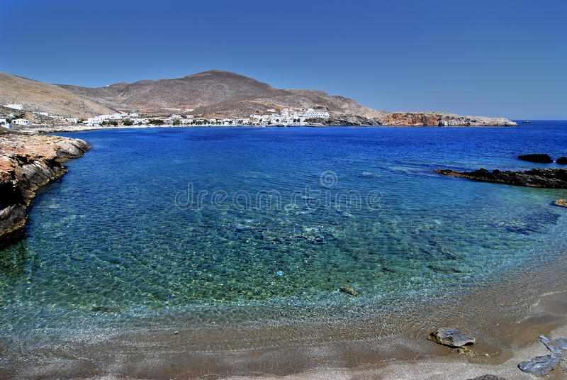 Beach in Folegandros island in Greece. Latinaki is a beautiful beach with clear turquoise water in Folegandros island, Cyclades, Greece stock image