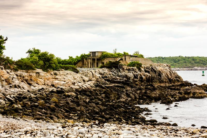 The Beach at Fort Williams with trees and Goddard Mansion in theBackground. Fort Williams Park is a major tourist attraction in CApe Elizabeth Maine. In the royalty free stock images