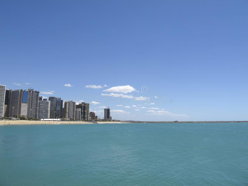 Beach in Fortaleza, Ceara, Brazil. Beach of Fortaleza, Ceara, northeastern coast of Brazil - concept of travel, rest and leisure in Brazil royalty free stock images