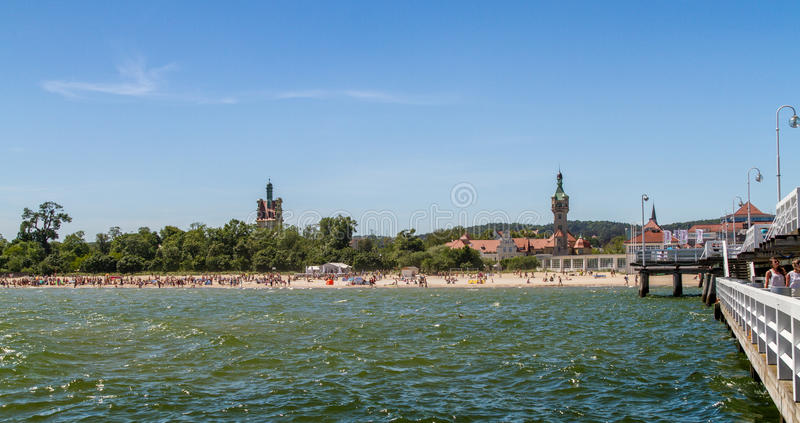 Beach in front of old lighthouse, Sopot royalty free stock image