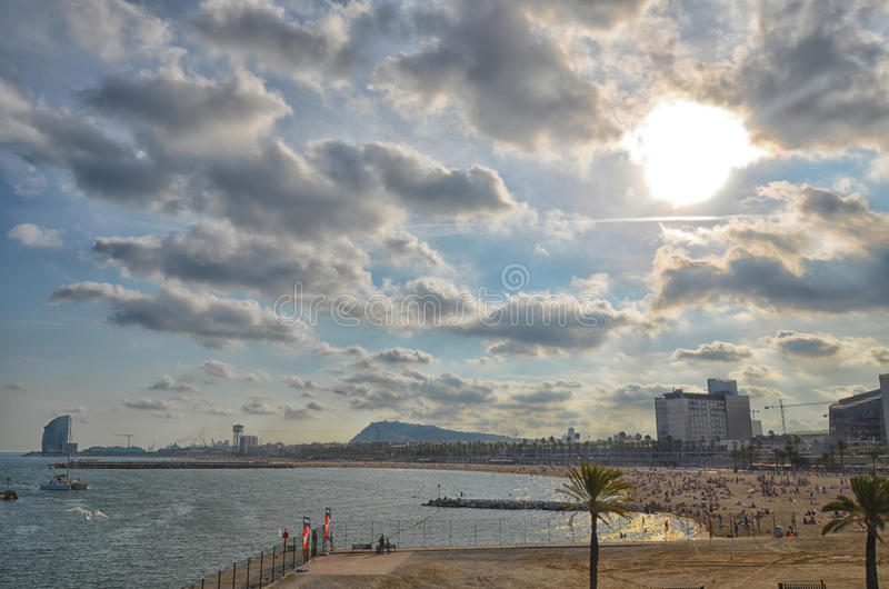 Beach full of people in Barcelona royalty free stock photos