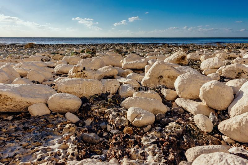 Calm beach full of rocks stock photo