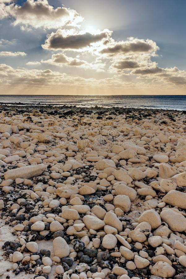 Beach full of rocks - relax, peaceful at sunset stock photo