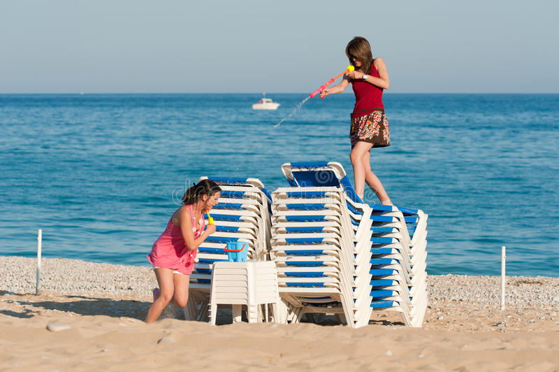 Download Beach fun stock photo. Image of enjoy, catfight, deckchair - 20032782