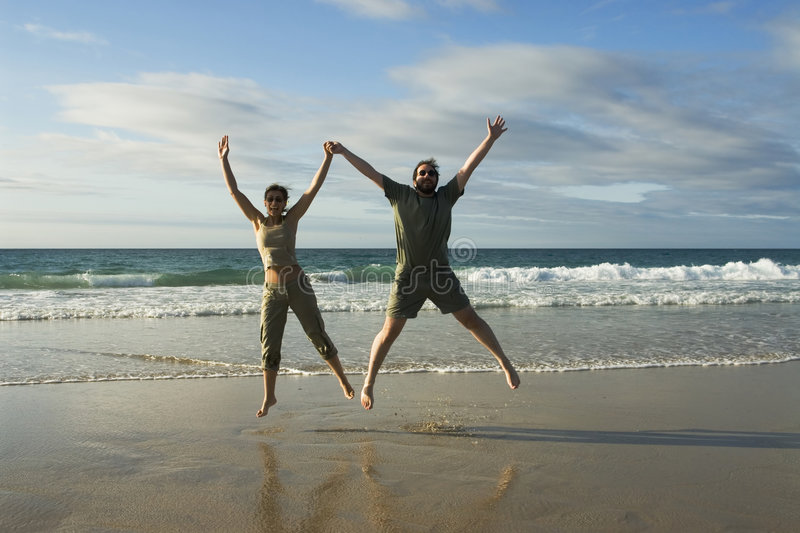 Download Beach fun stock image. Image of jump, vacation, blue, beach - 2950059