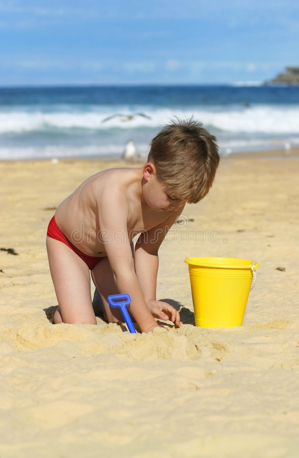 Beach Fun. A child enjoys the beach. Focus on boy royalty free stock image