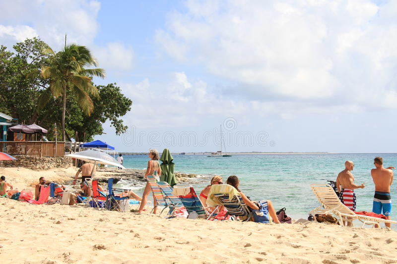 People relaxing on a beach royalty free stock photography