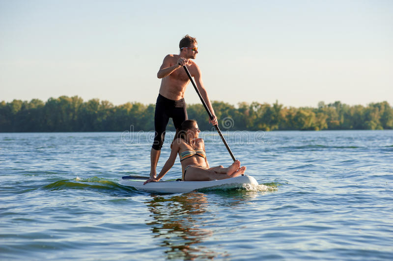 Beach fun couple on stand up paddle board SUP02 stock images