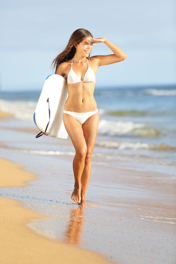 Beach fun woman going surfing with bodyboard. Beach fun woman surfing with bodyboard on summer vacation holidays travel. Beautiful hot girl in bikini looking at royalty free stock photography