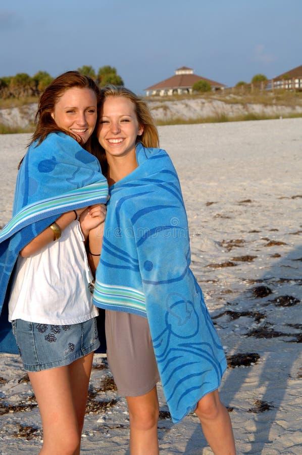 Beach girls in towel stock image