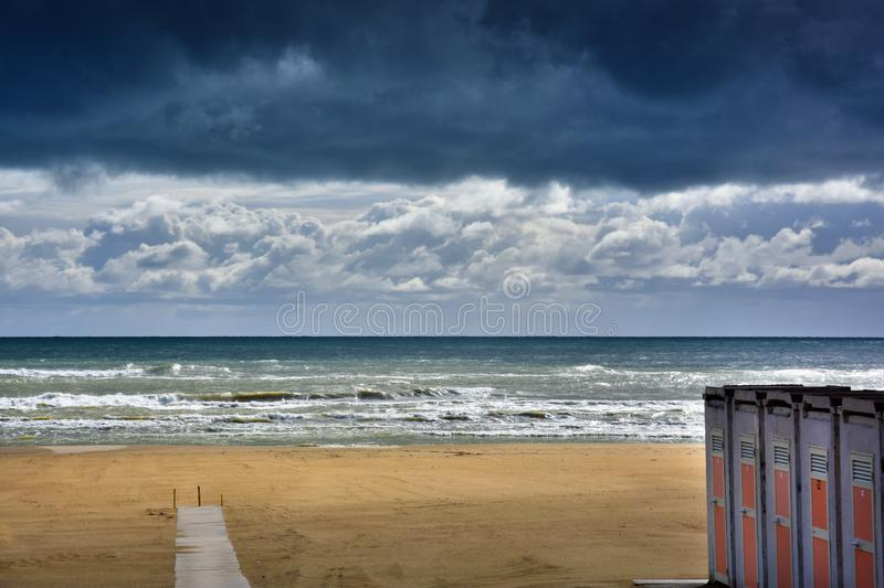 At the beach in Giulianova before the thunderstorm stock photography