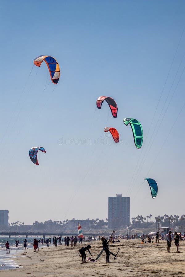 Beach goers and kiteboarder in Long Beach California royalty free stock photos