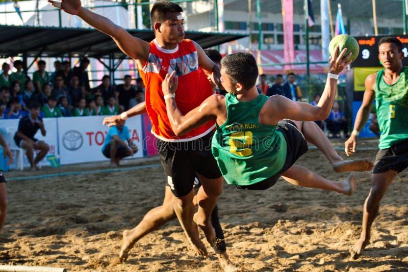 Beach Handball, player making a service at The 2018 Thailand National Games, Jiang Hai Games. Chiang Rai, Thailand - November 19, 2018 : Beach Handball player stock images