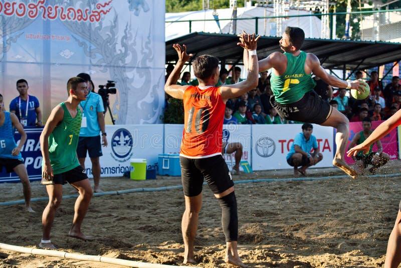 Beach Handball, player making a service at The 2018 Thailand National Games, Jiang Hai Games. Chiang Rai, Thailand - November 19, 2018 : Beach Handball player royalty free stock image